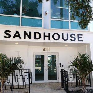 Building entrance to Sandhouse